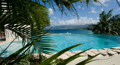 Views Over The Pool And Beach At Maca Bana - lobster in the Caribbean