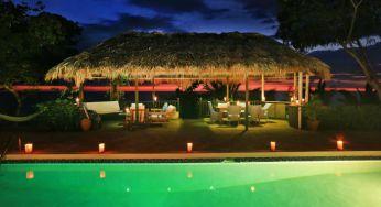 The calabash bay villa pool lit up at night at Jakes, Jamaica