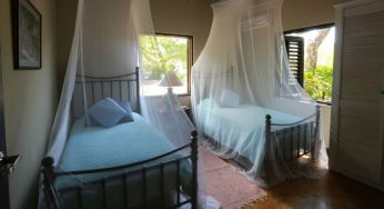 A bedroom in the calabash cottage at Jakes, Jamaica