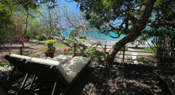 Grab some shade on the calabash cottage deck at Jakes, Jamaica